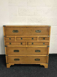 A 19th century style walnut military style multi drawer chest, with brass carry handles, retailed by Chapmans of Newcastle Upon Tyne, width 91cm.