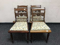 A set of four 19th century mahogany dining chairs upholstered in floral fabric. (4)