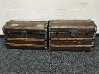 Two early 20th century cane bound dome top trunks. (2)