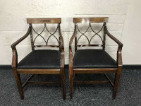 A pair of 19th century mahogany armchairs upholstered in black fabric, width 55cm. (2)