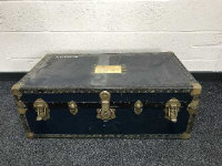 An early 20th century brass bound shipping trunk.