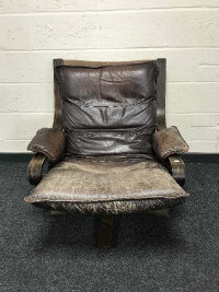 A mid 20th century brown leather swivel relaxer chair, width 75cm.