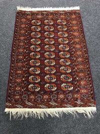 A Tekke rug, of traditional design, 155cm by 102cm.