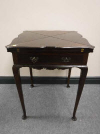 A late Victorian mahogany envelope games table and contents, width 56cm.