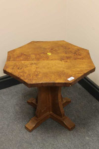 An Albert 'Eagleman' Jeffray oak octagonal coffee table, with carved eagle signature, width 52cm.