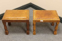 A pair of Albert 'Eagleman' Jeffray oak and studded leather footstools, with carved eagle signature, width 39cm.