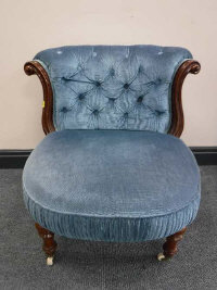 A Victorian mahogany button-back lady's chair, raised on ceramic castors, width 59cm.