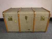 An early 20th century canvas and wooden bound travelling trunk, width 91cm.