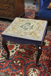 A mahogany tapestry upholstered stool on cabriole legs, in the 18th century style, width 51cm.