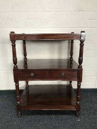 A three tier dumb waiter, fitted two drawers, width 78cm.