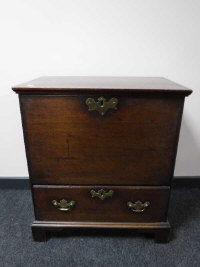 A George III oak chest fitted a drawer, raised on bracket feet, width 66cm.