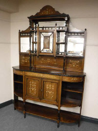 A late Victorian rosewood and satinwood inlaid bowfront mirror back sideboard, width 152cm.