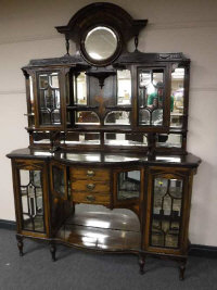 A late Victorian rosewood and satinwood inlaid serpentine front mirror back sideboard, width 168cm.