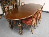 A Victorian mahogany wind out extending dinning table with two leaves, length extended 211cm, together with a set of six balloon back dining chairs.
