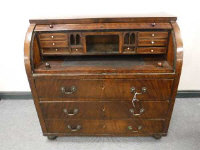 A 19th century mahogany cylinder bureau, with fitted interior, above three drawers, width 113cm.