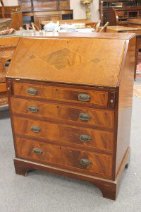 An inlaid mahogany bureau fitted four drawers, width 76cm.