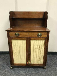 A Regency mahogany secretaire low cabinet, in the manner of Gillows, fitted a cupboard beneath, width 66 cm.