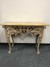 A Regency carved pine console table, with sienna marble top, on cabriole legs terminating in hoof feet, width 116 cm.