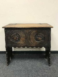 A 17th century style oak coffer on stand, width 83 cm.