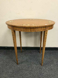 An Edwardian satinwood and polychrome painted oval occasional table, on tapered legs, width 74 cm.