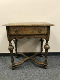 A William and Mary style oak side table fitted with a drawer, width 68 cm.
