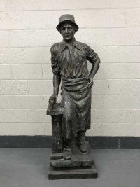 An impressive bronze statue - The Blacksmith, with hammer.