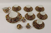 Twenty-four pieces of Royal Crown Derby Imari patterned china. (24)