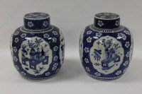 A pair of Chinese blue and white ginger jars, height 28 cm. (2)