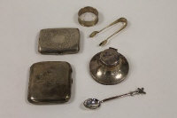 Two silver cigarette cases, together with a small silver inkwell, a napkin ring and continental teaspoon. (5)