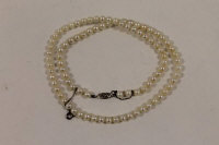 A pearl necklace with a 9ct white gold clasp.