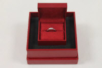An 18ct white gold Canadian Ice three-stone diamond ring, with GGI report, documents and original box.