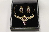 A 14ct gold ruby and diamond necklace, together with the matching pair of earrings. (3)