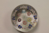 A Baccarat paperweight with millefiori canes depicting animals.