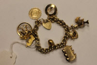 A 9ct gold bracelet and nine charms of various metal fineness.
