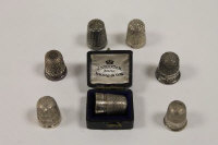 Six silver thimbles, together with a Charles Horner Dorcas thimble. (7)