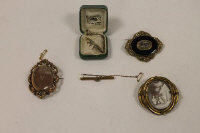 Two Victorian mourning brooches, together with three other late Victorian brooches. (5)