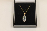 A 9ct gold aquamarine and diamond pendant on chain.