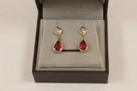 A pair of 18ct gold diamond and pink tourmaline earrings. (2)