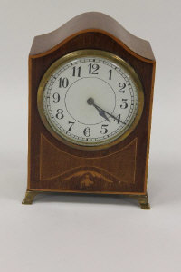 An Edwardian inlaid mahogany mantle clock, with key.