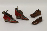 A pair of Chinese silk children's shoes, together with two wooden shoe frames. (4)