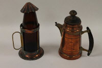 A late nineteenth century copper hot water jug, stamped DRGM, together with a copper lantern. (2)
