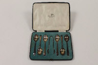A set of six silver teaspoons and pair of sugar tongs, Walker & Hall, Sheffield 1933, cased.