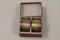 A pair of silver napkin rings, Birmingham 1922, cased.