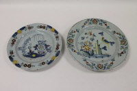 Two eighteenth century tin-glazed Delft chargers. (2)