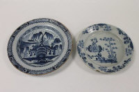 Two eighteenth century blue and white tin-glazed Delft chargers. (2)