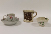 An eighteenth century porcelain cup and saucer, together with a small finger bowl and mug of the same age.  (4)