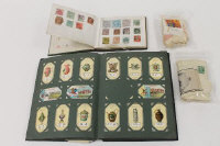 An album of stamps, together with an album of cigarette cards and a quantity of Kensitas silks. (Q)