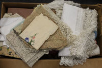 A quantity of vintage linen, cloths, embroidery and clothing. (Q)