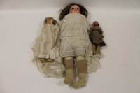 A Heubach bisque headed doll, numbered 275.4, together with a Hermsteiner doll and one other similar. (3)