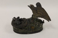 A late nineteenth century American cast iron money bank, 'Eagle and Eaglets', designed by Charles M Henn, height 15 cm.